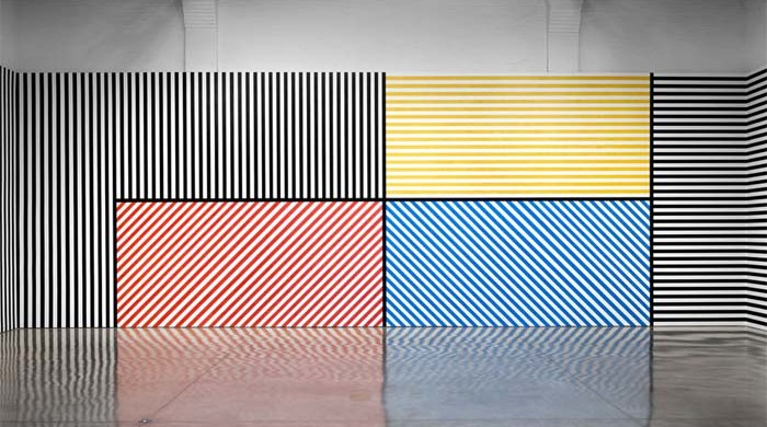 """Sol LeWitt, Wall Drawing #368: The wall is divided vertically into five equal parts. The center part is divided horizontally and vertically into four equal parts. Within each part are three-inch (7.5 cm) wide parallel bands of lines in four directions in four colors. In each of the other parts, three-inch (7.5 cm) bands of lines in one of the four directions. The bands are drawn in color and India ink washes. Red, yellow, blue, ink, India ink 3"""" (7.5 cm) bands, First Drawn by: Jo Watanabe and others, First Installation: Walker Art Center, Minneapolis, MN, January 1982, India Ink, dimensions variable."""
